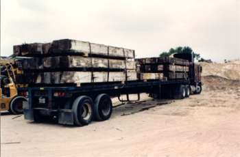 Heart Pine loaded onto a flatbed.  Just a small amount of the gigantic planks that were taken from the Building.  Photo courtesy Brandenburg.